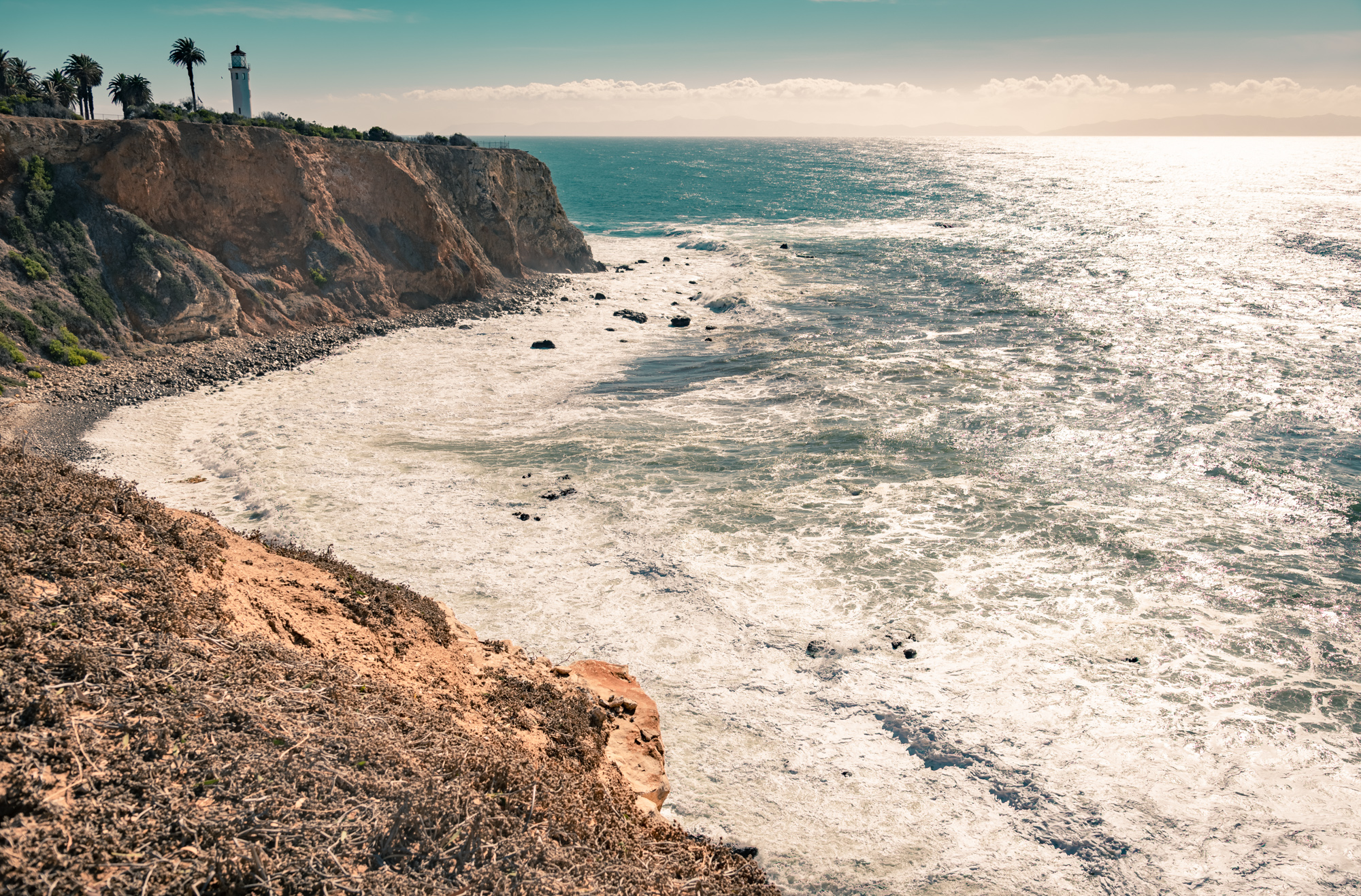 View of the Point Vicente Lighthouse over the rocky cliffs